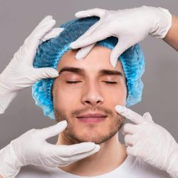 doctor-39-s-hands-in-gloves-checking-face-of-young-man.jpg